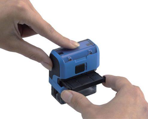 Comment changer l'encre d'un tampon automatique